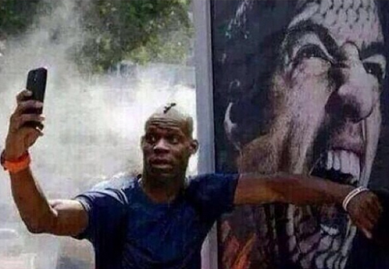 Balotelli make jest of Suarez biting scandal with his poster