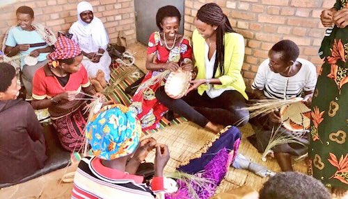 Ange Kagame practicing her basket weaving skills, with the amazing women over at the Rwanda Women's Opportunity Center in Kayonza